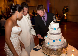 DJ Kevin assists a couple with the traditional cake cutting